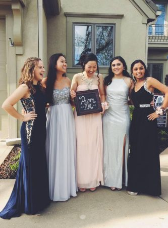 Juniors (on left) Lindsey Eckman, Rebecca Zhang, Irene Guo, Maggie Golshani and Meena Sreedhara pose together celebrating their first prom.