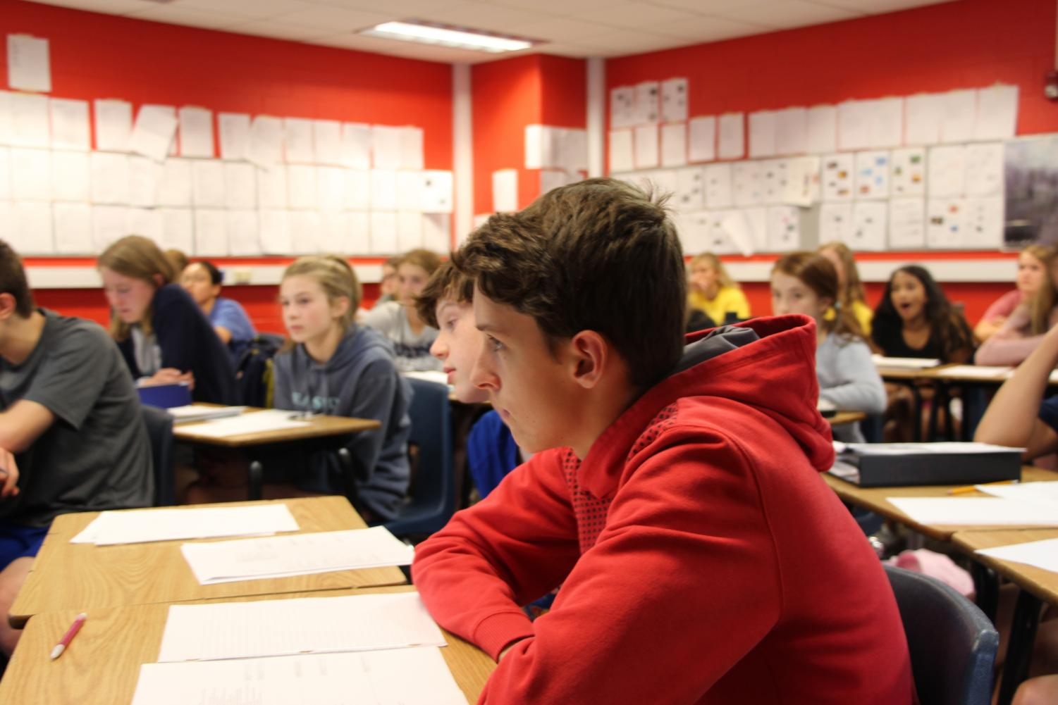 A freshman student listens to English teacher Todd Smith in ELA 9.