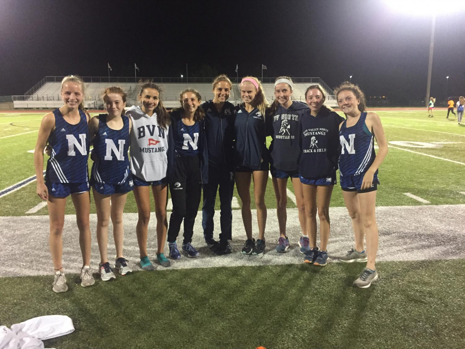 Varsity girls cross country finish second place at the the Olathe North Twilight Meet as a team.