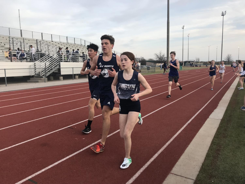 Freshmen Vivian Kane half way through her 3200m race.