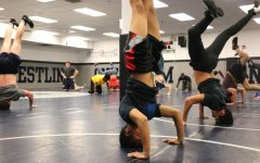 As part of warm ups for practice, Love balances in a handstand.