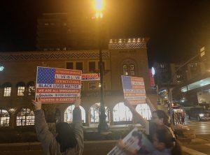 Two teen protestors carry signs advocating for the Black Lives Matter movement and other causes at the Country Club Plaza in downtown Kansas City, MO on Nov 7, 2020. Photo by Arshiya Pant.