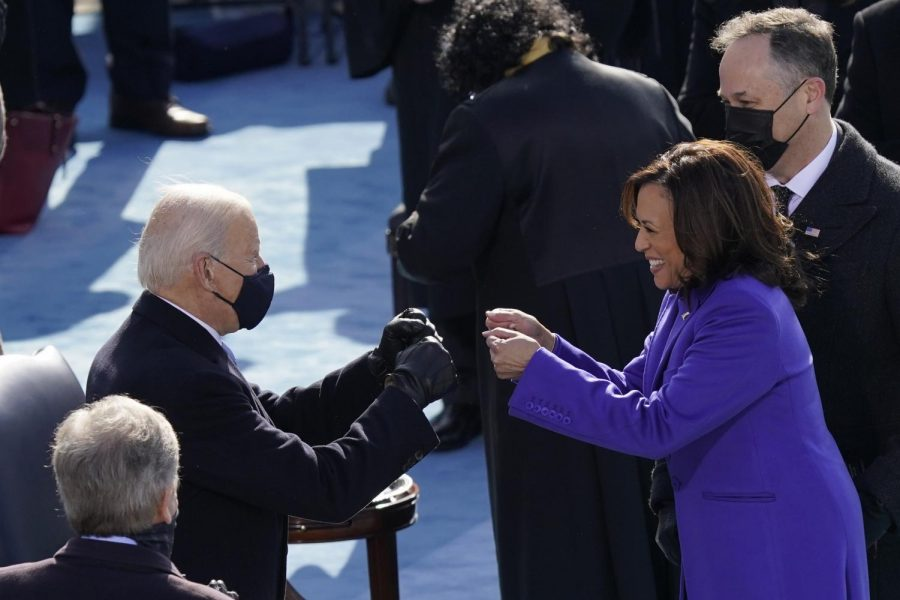 President Joe Biden and Vice President Kamala Harris celebrate the start of their terms at the Inauguration. Photo by Carolyn Kaster for The Associated Press.