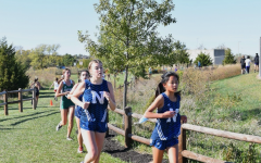 Talcott races to the finish line alongside her teammate freshman Marissa Freeman at the Blue Valley Southwest cross country course.