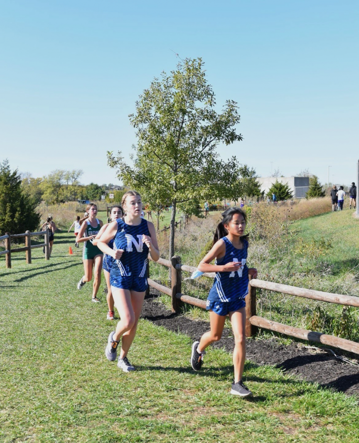 Talcott+races+to+the+finish+line+alongside+her+teammate+freshman+Marissa+Freeman+at+the+Blue+Valley+Southwest+cross+country+course.+