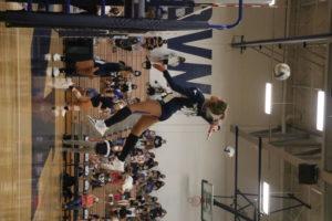 Jasmine Dulan spiking a ball. Photo by Reece Bachta